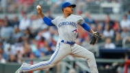 Toronto Blue Jays starting pitcher Marcus Stroman delivers in the first inning of the team's baseball game against the Atlanta Braves, Tuesday, July 10, 2018, in Atlanta. (AP Photo/Todd Kirkland)