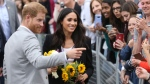 Britain's Prince Harry and Meghan, Duchess of Sussex, meet members of the public at Trinity college, Dublin, Ireland, Wednesday, July 11, 2018. (AP Photo/Peter Morrison)