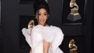 In this Jan. 28, 2018 file photo, Cardi B arrives at the 60th annual Grammy Awards in New York. (Photo by Evan Agostini/Invision/AP, File)