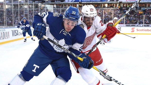 Toronto Maple Leafs centre Frederik Gauthier (33) and Detroit Red Wings left wing Drew Miller (20) battle for possession of the puck during first period NHL Centennial Classic hockey action in Toronto on Sunday, January 1, 2017. THE CANADIAN PRESS/Frank Gunn