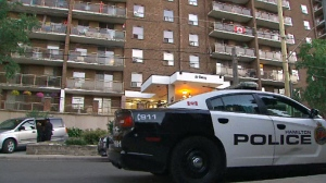 """Hamilton police at an apartment complex where a """"sudden death"""" investigation is being conducted after a six-year-old boy was found lying on the pavement."""