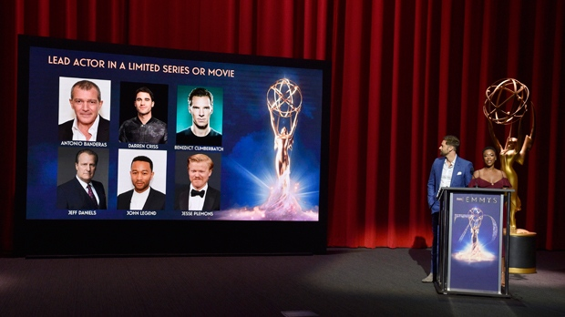 Ryan Eggold, left, and Samira Wiley announce the nominees for lead actor in a limited series or movie at the 70th Primetime Emmy Nominations Announcements at the Television Academy's Saban Media Center on Thursday, July 12, 2018, in Los Angeles. (Photo by Chris Pizzello/Invision/AP)