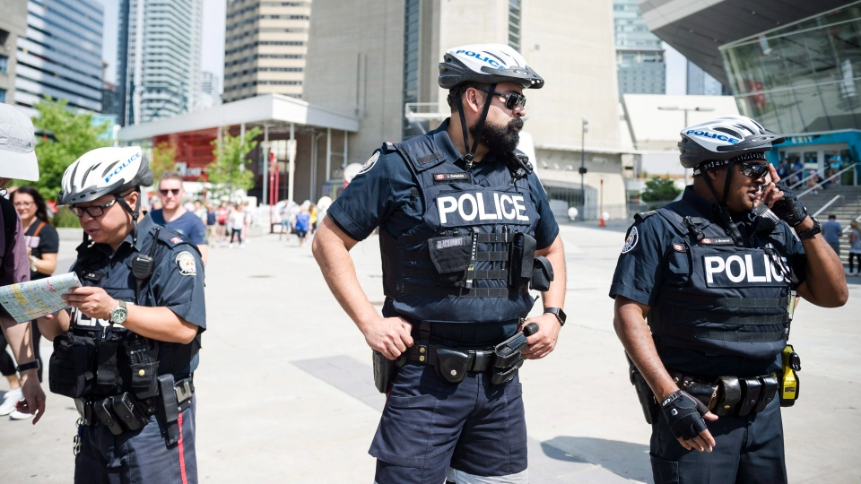 Police are seen in Toronto, on Thursday, July 12, 2018. THE CANADIAN PRESS/Christopher Katsarov