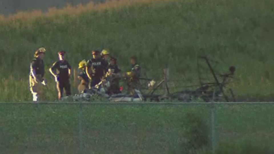 Crews are pictured at the wreckage following a small plane crash at Buttonville Airport in Markham Thursday July 12, 2018.