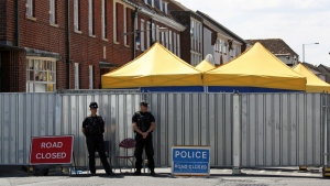 Police officers on duty in Salisbury, England, as the investigation into the death of Dawn Sturgess, who died after being exposed to nerve agent Novichok, continues, Tuesday July 10, 2018.  (Rod Minchin/PA via AP)