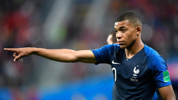 France's Kylian Mbappe points with his finger during the semifinal match between France and Belgium at the 2018 soccer World Cup in the St. Petersburg Stadium in St. Petersburg, Russia, Tuesday, July 10, 2018. (AP Photo/Martin Meissner)