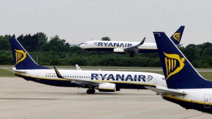 In this Tuesday July 21, 2009 file photo, Ryanair planes parked at Stansted Airport in England. (AP Photo/Matt Dunham, File)