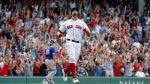 Boston Red Sox' Xander Bogaerts shouts while rounding the bases after hitting grand slam in the 10th inning as Toronto Blue Jays catcher Luke Maile walks off the field in a baseball game Saturday, July 14, 2018, in Boston. The Red Sox won 6-2. (AP Photo/Winslow Townson)