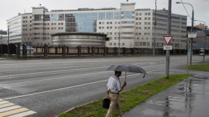 A man walks past the building of the Russian military intelligence service in Moscow, Russia, Saturday, July 14, 2018. U.S. President Donald Trump on Saturday scolded the Obama administration for not responding aggressively enough to Russian hacking of Democratic targets in the 2016 U.S. election's, cyberattacks underpinning the indictment of 12 Russian military intelligence officers. Trump's first response to special counsel Robert Mueller's initial charges against Russian government officials for interfering in American politics came in tweets the president posted while at his golf resort in Scotland, two days before a high-stakes summit in Finland with Russian leader Vladimir Putin. (AP Photo/Pavel Golovkin)