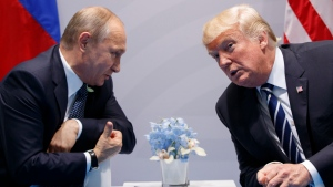 FILE - In this July 7, 2017 file photo U.S. President Donald Trump meets with Russian President Vladimir Putin at the G-20 Summit in Hamburg. Both leader will meet for summit on Monday, July 16, 2018 in Helsinki, Finland. (AP Photo/Evan Vucci, file)