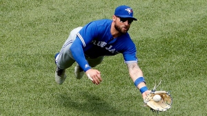 Toronto Blue Jays center fielder Kevin Pillar makes a diving catch on Boston Red Sox's Brock Holt during the third inning of a baseball game Saturday, July 14, 2018, in Boston. (AP Photo/Winslow Townson)