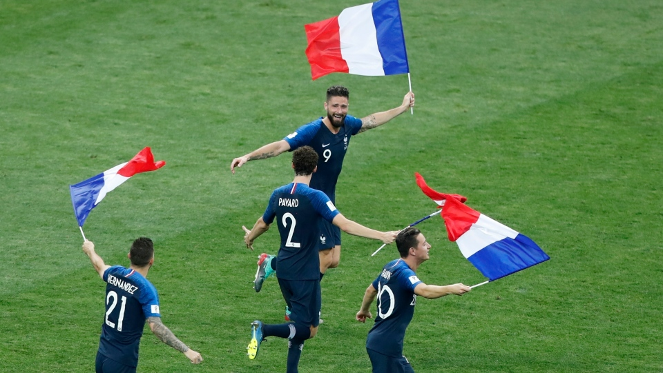 French players celebrate at the end of the final match between France and Croatia at the 2018 soccer World Cup in the Luzhniki Stadium in Moscow, Russia, Sunday, July 15, 2018. France won 4-2. (AP Photo/Frank Augstein)
