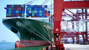 In this July 6, 2018, file photo, a ship hauls containers at a container port in Qingdao in eastern China's Shandong province. (Chinatopix via AP, File)