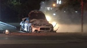 "A ""suspicious"" vehicle fire destroyed a Maserati at an Etobicoke parking lot on Sunday night. (Mike Nguyen/ CP24)"