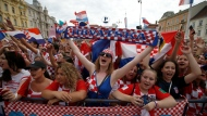 Supporters of Croatia national soccer team members wait to welcome the team on their arrival in Zagreb, Croatia, Monday, July 16, 2018. Euphoria gave way to a mixture of disappointment and pride for Croatia fans after their national team lost to France in its first ever World Cup final. (AP Photo/Darko Vojinovic)