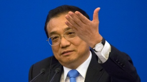 "Chinese Premier Li Keqiang speaks at the China-EU Business Roundtable held at the Great Hall of the People in Beijing, China, Monday, July 16, 2018. Premier Li said Monday that China and the EU had agreed to take steps to ""safeguard free trade"" and the global multilateral regulatory system. He endorsed efforts to update World Trade Organization rules that Washington complains are outdated and cumbersome.(AP Photo/Ng Han Guan, Pool)"