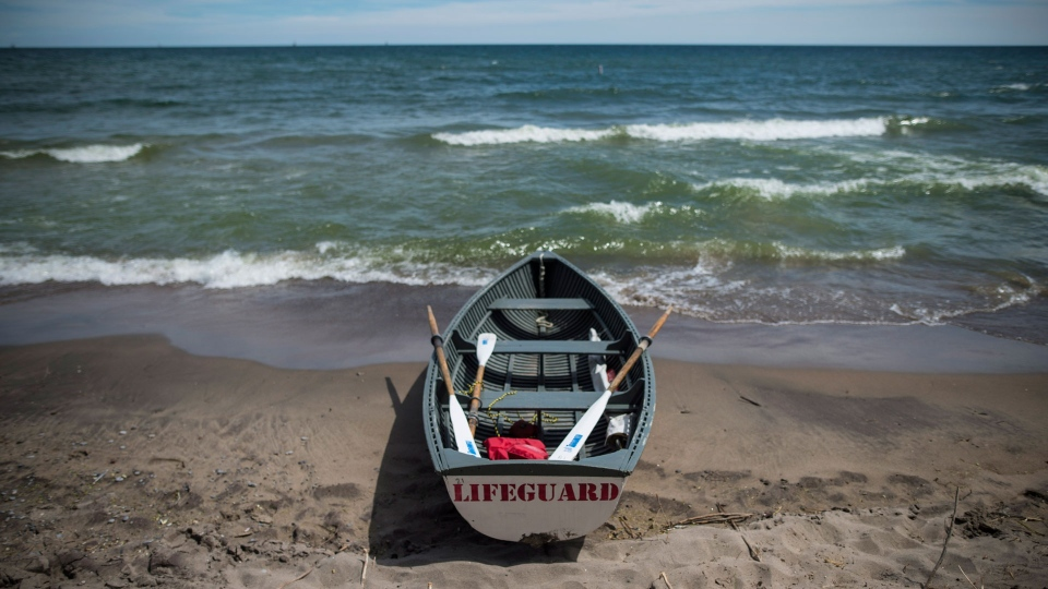 A lifeboat sits along the Gibraltar Point Beach on Toronto Island on Thursday, June 21, 2018. THE CANADIAN PRESS/ Tijana Martin