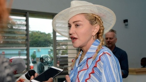 U.S. singer Madonna speaks to the press at a news conference in Blantyre, Malawi, Monday, July 16, 2018. (AP Photo/Thoko Chikondi)