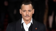 "In this Nov. 2, 2017, file photo, actor Johnny Depp poses at the world premiere of the film ""Murder on the Orient Express,"" in London. Depp has settled lawsuits with his former business managers that put a spotlight on the actor's spending. Depp's representatives said on Monday, July 16, 2018, that Depp had settled litigation filed against The Management Group, which he accused in January 2017 seeking more than $25 million over alleged financial abuse and negligence. (Photo by Vianney Le Caer/Invision/AP, File)"