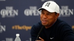 Tiger Woods of the United States smiles as answers a question at a press conference for the 147th British Open Golf championships in Carnoustie, Scotland, Tuesday, July 17, 2018. The Opens Golf championships start Thursday. (AP Photo/Alastair Grant)
