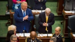 Ontario Premier Doug Ford applauds following the first Session of the 42nd Parliament of Ontario at Queen's Park in Toronto on Thursday, July 12, 2018. THE CANADIAN PRESS/ Tijana Martin