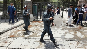 Security personnel arrived at the site of a would-be suicide attack near a park in Kabul, Afghanistan, Monday, July 16, 2018. (AP Photo/Rahmat Gul)