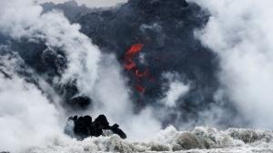 In this May 20, 2018 file photo, lava flows into the ocean near Pahoa, Hawaii.  (AP Photo/Jae C. Hong, File)