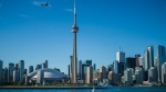 The Toronto skyline is photographed from the Hanlan's Point Ferry as it travels back to the city on Thursday, June 21, 2018. THE CANADIAN PRESS/ Tijana Martin