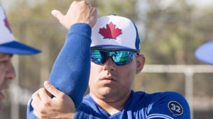 Toronto Blue Jays relief pitcher Roberto Osuna warms up at spring training in Dunedin, Fla., on Wednesday, February 21, 2018. Major League Baseball has suspended Toronto Blue Jays closer Roberto Osuna through Aug. 4. he Toronto Blue Jays plan to use right-hander Roberto Osuna in his usual closer's role when he becomes eligible to return to the team. THE CANADIAN PRESS/Frank Gunn