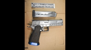 A handgun seized by Toronto police after an investigation in Brookhaven is seen. (Toronto police handout)