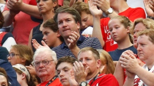 Supreme Court nominee Brett Kavanaugh, center, watches events on the field from the stands before the Major League Baseball All-Star Game, Tuesday, July 17, 2018, in Washington.(AP Photo/Patrick Semansky)
