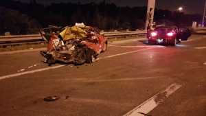 The wreckage of a three-vehicle crash is pictured in the eastbound collector lanes of Highway 401 near Leslie Street Monday July 18, 2018. (Handout /OPP)