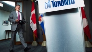 Toronto Mayor John Tory arrives to speak during a press conference regarding new tactics for the ongoing gun shootings in Toronto on Wednesday, July 18, 2018.THE CANADIAN PRESS/Nathan Denette