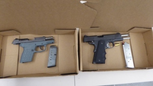 A 9mm handgun (left) and a .45 calibre handgun (right) seized last week are shown in a handout image from TPS.