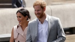 Britain's Prince Harry, right, and his wife Meghan the Duchess of Sussex arrive for their visit to the launch of the Nelson Mandela Centenary Exhibition, marking the 100th anniversary of anti-apartheid leader's birth, at the Queen Elizabeth Hall in London, Tuesday, July 17, 2018. (AP Photo/Matt Dunham)