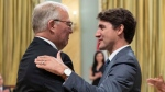 Bill Blair is congratulated by Prime Minister Justin Trudeau after being sworn in as Minister of Border Security and Organized Crime Reduction during a ceremony at Rideau Hall in Ottawa on Wednesday, July 18, 2018. THE CANADIAN PRESS/Justin Tang