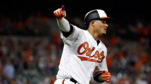 Baltimore Orioles' Manny Machado gestures as he rounds the bases on his two-run home run in the seventh inning of a baseball game against the New York Yankees, Tuesday, July 10, 2018, in Baltimore. (AP Photo/Patrick Semansky)