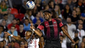 Ottawa Fury FC's Eddie Edward (3) heads the ball against Toronto FC's Ryan Telfer (54) during second half Canadian Championship soccer action in Ottawa on Wednesday, July 18, 2018. THE CANADIAN PRESS/Justin Tang