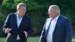 Saskatchewan Premier Scott Moe, left, and Ontario Premier Doug Ford walk to a reception as the Canadian premiers meet in St. Andrews, N.B., on Wednesday, July 18, 2018. THE CANADIAN PRESS/Andrew Vaughan