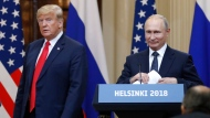 FILE - In this July 16, 2018, file photo, U.S. President Donald Trump, left, and Russian President Vladimir Putin arrive for a press conference after their meeting at the Presidential Palace in Helsinki, Finland. If Donald Trump is serious about his public courtship of Vladimir Putin, he may want to take pointers from one of the Russian leader's longtime suitors: Chinese President Xi Jinping. In this political love triangle, Putin and Xi are tied by strategic need and a rare dose of personal affection, while Trump's effusive display in Helsinki showed him as an earnest admirer of the man leading a country long considered America's adversary. (AP Photo/Alexander Zemlianichenko, File)
