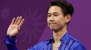 In this Feb. 16, 2018 file photo, figure skater Denis Ten, of Kazakhstan, reacts as his score is posted following his performance in the men's short program figure skating, in the Gangneung Ice Arena at the 2018 Winter Olympics in Gangneung, South Korea. Prosecutors in Kazakhstan said Thursday, July 19, 2018, that Olympic figure skating medalist Denis Ten has been killed, and they are treating the case as murder.  (AP Photo/David J. Phillip, File)