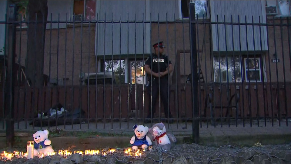 A police officer stands guard outside the home of a five-year-old Brampton boy who was found with critical injuries after being reported missing Thursday July 19, 2018.