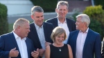 Ontario Premier Doug Ford, left to right, Nova Scotia Premier Stephen McNeil, Alberta Premier Rachel Notley, Manitoba Premier Brian Pallister and Newfoundland and Labrador Premier Dwight Ball chat as they wait for the official photo at the meeting of Canadian premiers in St. Andrews, N.B., on Wednesday, July 18, 2018. THE CANADIAN PRESS/Andrew Vaughan