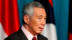 FILE - In this April 28, 2018, file photo, Singapore's Prime Minister Lee Hsien Loong speaks during a press conference to mark the end of the 32nd ASEAN Summit in Singapore. (AP Photo/Yong Teck Lim, File)