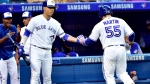 Toronto Blue Jays shortstop Aledmys Diaz (1) congratulates teammate Russell Martin (55) after his solo home run during fifth inning MLB baseball action against the Baltimore Orioles, in Toronto on Friday, July 20, 2018. THE CANADIAN PRESS/Frank Gunn