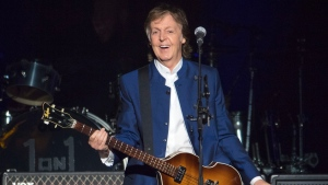 FILE - In this Monday, July 10, 2017 file photo, Sir Paul McCartney performs at Amalie Arena in Tampa, Fla. Most hosts would be quite happy to have Paul McCartney come to a shindig. But that wasn't the case with Denis Thatcher in 1988 when planning a gala reception at 10 Downing Street. Papers released on Saturday, July 21, 2018 show that the late husband of former British Prime Minister Margaret Thatcher put a question mark next to the former Beatle's name on a proposed guest list he was reviewing.(AP Photo/Scott Audette)