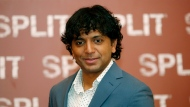"FILE- In this Jan. 11, 2017 file photo, director M. Night Shyamalan poses during a photo call for the movie ""Split"" in Milan, Italy, Shyamalan says he could have launched the trailer for ""Glass"" in front of the summer's biggest movies in theaters, but that he wanted to hold it for Comic-Con. The filmmaker said Friday, July 20, 2018, at the annual comic book convention that he felt strongly that the Hall H audience should be the first to see it. (AP Photo/Antonio Calanni, File)"