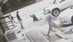 In surveillance footage provided by Pinellas County Sheriff's Department a man on the ground can be seen aiming and firing a handgun at Markeis McGlockton on July 20, 2018. (Pinellas County Sheriff's Department/YouTube)