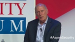 In this image from video provided by the Aspen Security Forum, National Intelligence Director Dan Coats speaks at the Forum in Aspen, Colo., on Thursday, July 19, 2018. (Aspen Security Forum via AP)
