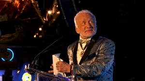 FILE - In this July 15, 2017, file photo, Apollo 11 astronaut Buzz Aldrin speaks at the commemoration for the upcoming anniversary of the 1969 mission to the moon and a gala for his non-profit space education foundation, ShareSpace Foundation, at the Kennedy Space Center in Cape Canaveral, Fla. Aldrin is expected to be noticeably absent from a gala kicking off a yearlong celebration of the 50-year anniversary of the first moon landing, even though his foundation is a sponsor and he typically is the star attraction. Organizers haven't heard one way or another if Aldrin is attending Saturday, July 21, 2018 evening's Apollo Celebration Gala at the Kennedy Space Center in Florida, but they expect him to be a no-show. (AP Photo/Alex Sanz, File)
